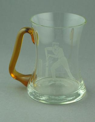 Glass mug with cricket design after illustration by Nicholas Felix, 'Home Block'