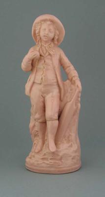 Pink ceramic figurine of boy with cricket bat