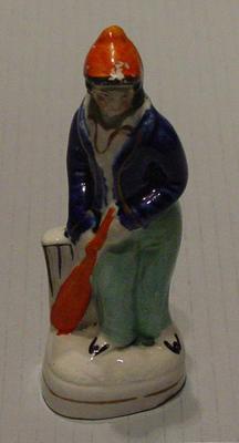 Ceramic Staffordshire figurine of boy holding a cricket bat; Domestic items; M5320.2