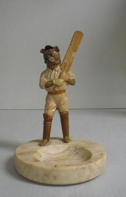 Ashtray, figurine of a dog with a cricket bat