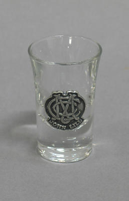 Shot glass with MCC logo and inscription 'John Lill'