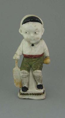 Figurine of a boy cricketer