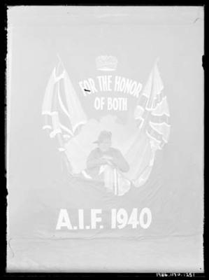 Glass negative, image of unknown man in military attire with AIF flag
