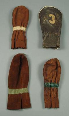 Four leather golf club covers, c1930s
