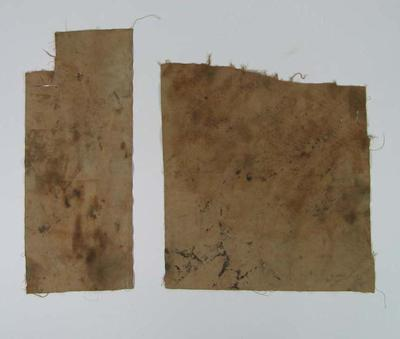 Two pieces of cloth, associated with junior cricket kit c1940s