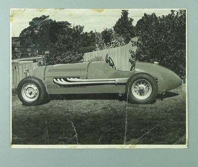 Photograph of racing car, undated
