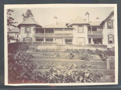 Photograph from Frank Laver's photograph album, image of large house c1910; Photography; M10728.34