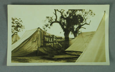 """Photograph of pennant on display, """"MCC Rifle Pennant 1923-1924, No. 21 Union"""""""