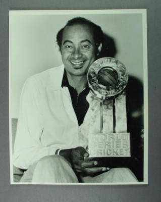 Photograph, Dr Rudi Webster with Sir Garfield Sobers World Series Cricket Trophy