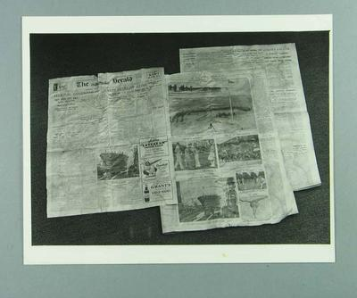 Photograph, depicts three newspapers that were found in the 1928 MCC time capsule