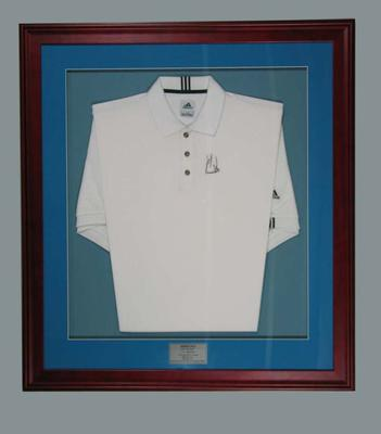 White ADIDAS collared shirt signed by Ernie Els on the front left hand side