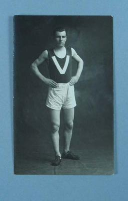 Postcard featuring black and white image of man in sporting attire