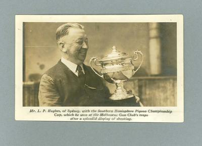 Photograph of Mr L.P. Hughes of Sydney with the Southern Hemisphere Pigeon Championship Cup 1934