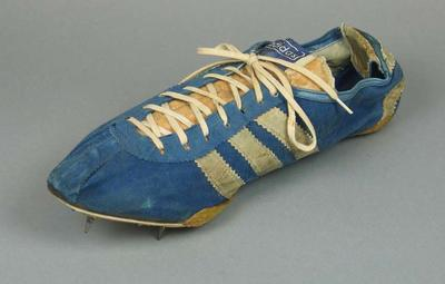 One running shoe with spikes worn by Betty Cuthbert in 1964