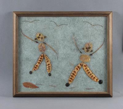 Collage of two cricket fielders, assembled from seed pods, leaves & twigs