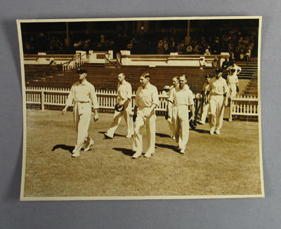 Photograph of Victorian cricket team taking the field, c1920s-30s