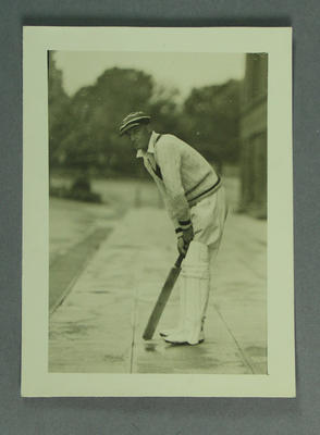 Photograph of Keith Rigg, posed with cricket bat