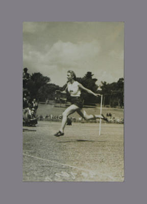 Photograph of Shirley Strickland during running race, c1930s-40s