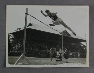 Photograph of unidentified man performing a high jump, undated