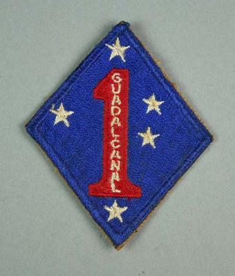 Cloth badge issued to US Marines based at Guadalcanal during WWII; Clothing or accessories; M15924