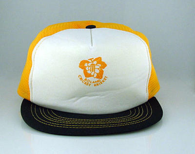 Cap - yellow and white with 'Boland Cricket Krieket ' on front; Clothing or accessories; M11677