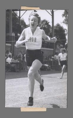 Photograph of Shirley Strickland at finish line, undated