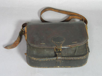 Leather shoulder bag containing shooting equipment, used by Leonard Righetti c1920s