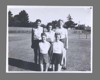 Photograph of Shirley Strickland with athletic club team mates, 1947-48