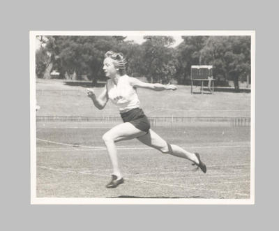 Photograph of Shirley Strickland crossing finish line, undated