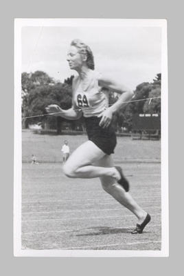 Photograph of Shirley Strickland crossing finish line, c1940s