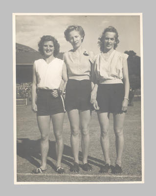 Photograph of Shirley Strickland with two female athletes, undated