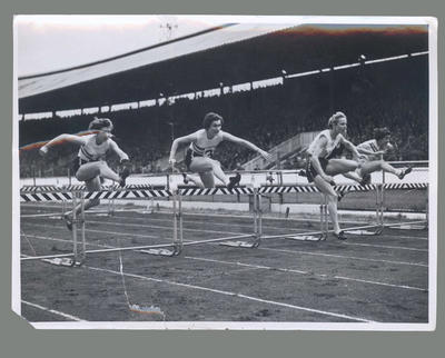 Photograph of Shirley Strickland competing in hurdles event, c1948