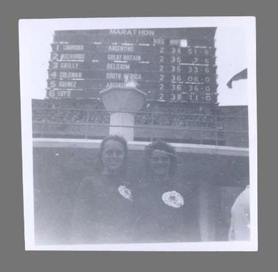 Photograph of Betty McKinnon & June Maston with Olympic Flame, 1948 Olympic Games