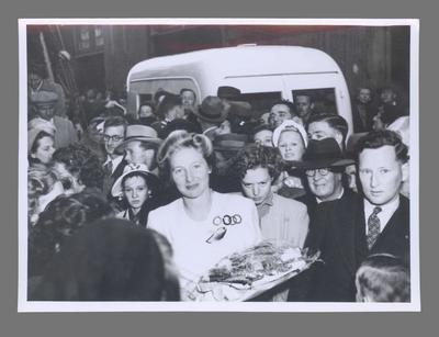 Photograph of Shirley Strickland in a crowd wearing Olympic uniform, c1948