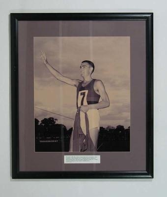 Reproduction photograph - Ron Clarke acknowledging the crowd, December 1964; Photography; Framed; 2004.4046