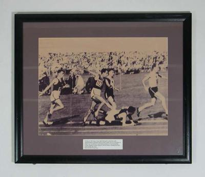 Reproduction photograph - John Landy trying to avoid Ron Clarke fall 10 March 1956, Olympic Park track; Photography; Framed; 2004.4048
