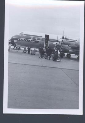 Photograph of group boarding Ansett aeroplane