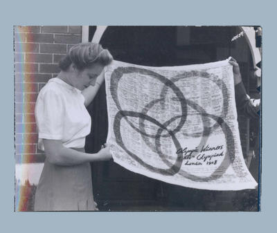 Photograph of Shirley Strickland with 1948 Olympic Games commemorative scarf
