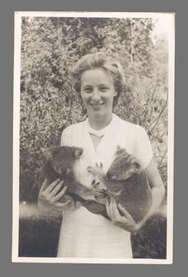 Photograph of Shirley Strickland with koalas, c1949
