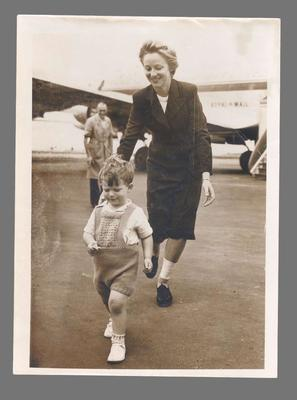 Photograph of Shirley Strickland with a small boy on airport tarmac, c1949; Photography; 2003.3903.380