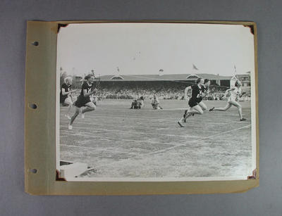 Page from photo album, depicts finish line of 80m hurdles event - 1950 British Empire Games