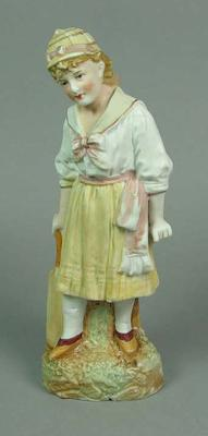 Painted bone china figurine of a girl cricketer holding a cricket bat