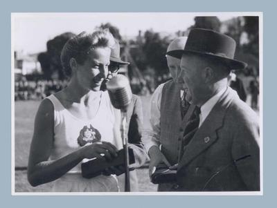 Photograph of Shirley Strickland at presentation ceremony, Hobart c1950