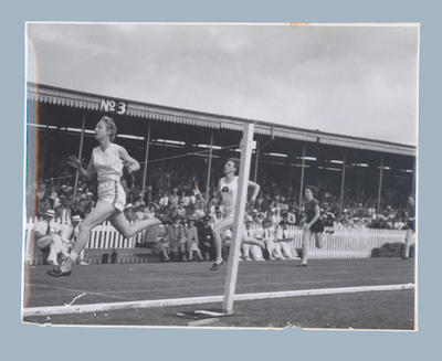 Photograph of Shirley Strickland winning 200m race, Canterbury Centennial Games