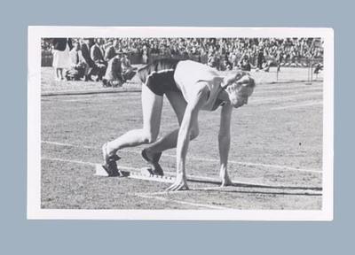 Photograph of Shirley Strickland on starting blocks, c1952