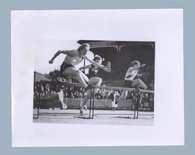 Photograph of Shirley Strickland during a hurdles race, c1952