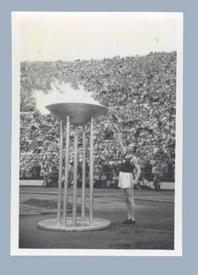 Photograph of Paavo Nurmi, lighting 1952 Helsinki Olympics cauldron