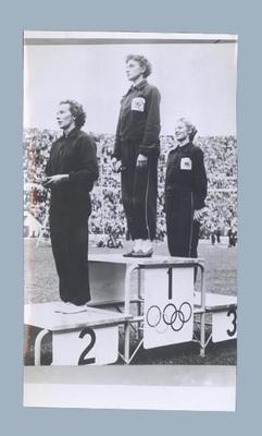 Photograph of women's 100m place getters on podium, 1952 Olympic Games