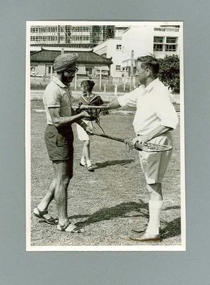 Black and white photograph Australian Lacrosse Team Member and Indian player, Hong Kong 1967; Photography; 1986.1443.2