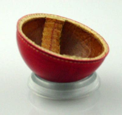 Outer half of a red leather cricket ball c. 1940s; Sporting equipment; M10548.7